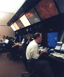 An air traffic controller using a display system at an Air Route Traffic Control Center