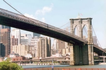 The Brooklyn Bridge spans the East River between Manhattan and Brooklyn