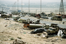 "Demolished vehicles line Highway 80, also known as the ""Highway of Death"""