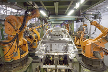 Industrial robots assembling automobiles
