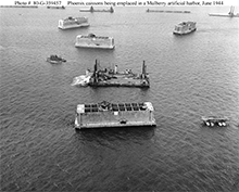 Phoenix caissons being towed to form a Mulberry harbor off Normandy, June 1944