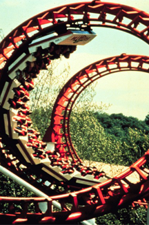 A modern roller coaster showing an inverted portion of the trip