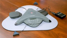 A speakerphone of a type in common use for teleconferences