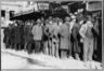 Bowery men waiting for bread in a bread line in New York City in 1910