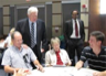 U.S. Congressman Jim Moran talks with constituents at a meeting on the federal budget