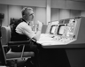 Eugene F. Kranz, flight director, at his console on May 30, 1965, in the Control Room in the Mission Control Center at Houston