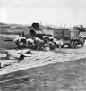 Soldiers of IX Engineering Command, U.S. Army Air Force, putting down a Pierced Steel Planking (PSP) Runway at an Advanced Landing Ground under construction somewhere in France following the Normandy Landings of World War II