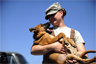 U.S. Air Force Staff Sgt. Christa Quam holds her puppy