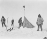Robert F. Scott and three of his party arrive at a tent left by Roald Amundsen near the South Pole