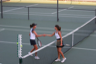 Tennis players shake hands after their match
