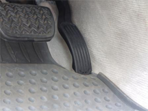 Example of an unsecured driver-side floor mat trapping the accelerator pedal in a 2007 Toyota Lexus ES350