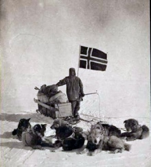 Oscar Wisting, a member of Roald Amundsen's party, and his dog team at the South Pole in 1911