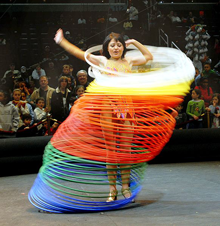 A member of Ringling Bros. and Barnum & Bailey Circus keeps 60 hula hoops going at once during her pre-show act March 27, 2008