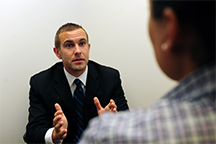An investigator from the U.S. Air Force Office of Special Investigations interviews a witness