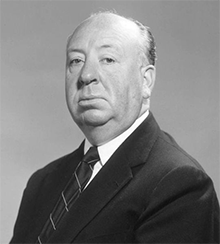A studio publicity photo of Alfred Hitchcock