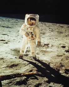 An astronaut standing on the surface of the moon