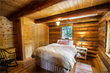 A bedroom in a log home