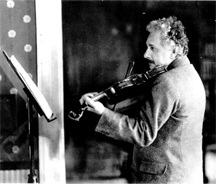 Albert Einstein playing his violin on his 50th birthday in 1929