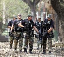 An FBI SWAT team assists local law enforcement in New Orleans in August 2005