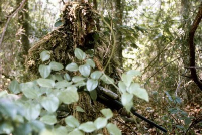 A U.S. Marine sniper wearing sniper camouflage gear known as a