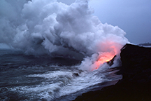 Glow of lava reflected in steam plume east of Kupapa'u Point, on the Big Island of Hawaii