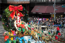 Santa Claus arrives at 57th and Broadway in New York in the Macy's Thanksgiving Day Parade
