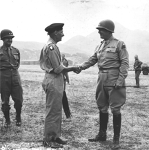 Gen. George S. Patton, Jr., (right) bids farewell to Gen. Bernard Montgomery (left) at the Palermo airport