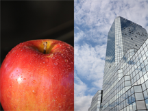 An apple and a skyscraper full of windows